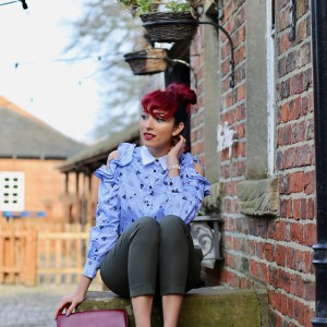 The ruffle cold shoulder blouse trend